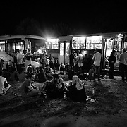 Refugees wait by night at the Köszke's train station, Hungary, to take a train, chartered by the hungarian authorities, to go to the austrian border, on september 14, 2015. According to the new hungarian laws, refugees cannot cross the border anymore, excepting in specific control points, otherwise, they will be considered as illegal and will be detained or accompanied back to the border they crossed.