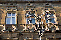 picture showing antique street lamp and old facade behind on a sunny afternoon in krakow old town poland