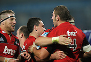 Crusaders players congratulate Luke Romano on his try. Super 15 rugby union match - Crusaders v Chiefs at McLean Park, Napier, New Zealand on Saturday, 21 May 2011. Photo: Dave Lintott / photosport.co.nz