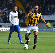 Byron Moore looks to cross the ball and open up bury during the Sky Bet League 1 match between Bury and Port Vale at Gigg Lane, Bury, England on 19 September 2015. Photo by Mark Pollitt.