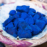 Chunks of Majorelle blue indigo pigment for sale in the market stalls in the Medina of Marrakesh, Morocco.