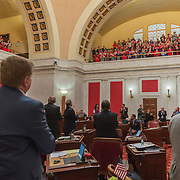 State senators acknowledge the cheers of teachers and school personnel after the passage of a bill to increase pay of state workers by 5% at the capitol in Charleston, W.V., on Tuesday, March 06, 2018; the ninth day of statewide school closures.