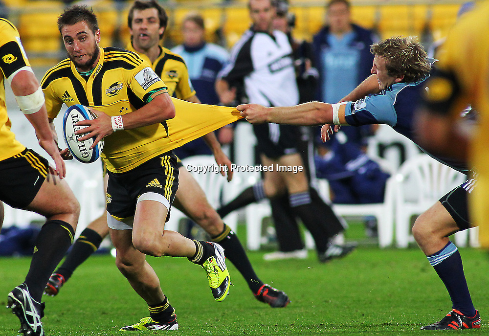 Andre Taylor is caught by his jumper in a tackle during their Super Rugby match, Hurricanes v Blues, Westpac stadium, Wellington, New Zealand. Friday 4 May 2012.  PHOTO: Grant Down / photosport.co.nz