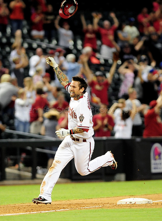 Sep. 27 2011; Phoenix, AZ, USA; Arizona Diamondbacks infielder Ryan Roberts (24) celebrates after hitting a walk off grand slam during the tenth inning against the Los Angeles Dodgers at Chase Field. The Diamondbacks defeated the Dodgers 7-6 in extra innings.  Mandatory Credit: Jennifer Stewart-US PRESSWIRE.
