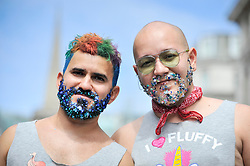 © Licensed to London News Pictures. 08/07/2017. London, UK. Men with coloured beards watch the parade.  Tens of thousands of visitors, many wearing eye-catching costumes, gather to watch and take part in the annual Pride in London Parade, the largest celebration of the LGBT+ community in the UK.   Photo credit : Stephen Chung/LNP