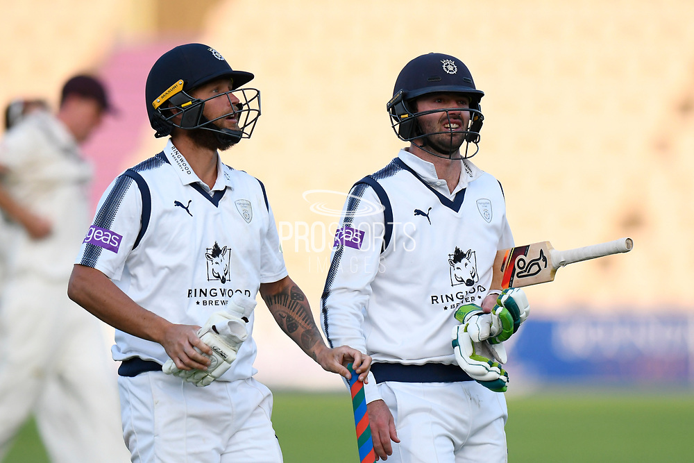 Batsmen Gareth Berg of Hampshire and Ian Holland of Hampshire walk of the field at the end of play on day 2 during the Specsavers County Champ Div 1 match between Hampshire County Cricket Club and Surrey County Cricket Club at the Ageas Bowl, Southampton, United Kingdom on 6 September 2017. Photo by Graham Hunt.