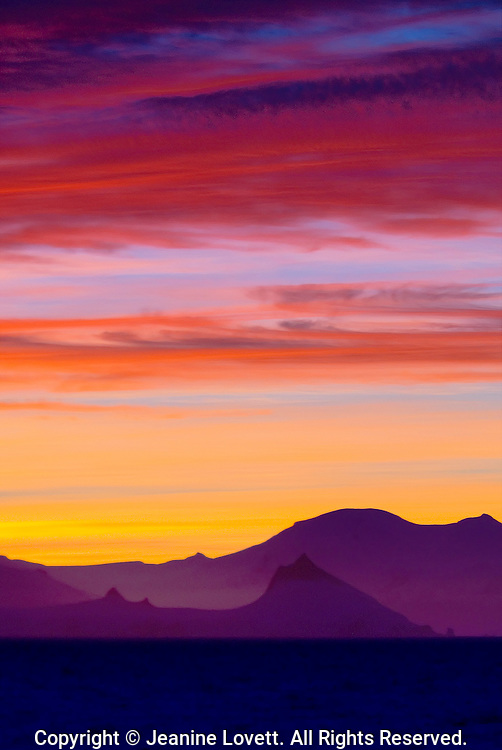 Antarctic Peninsula two mountains, one in front of the other with a wild color sunset lasted for hours.