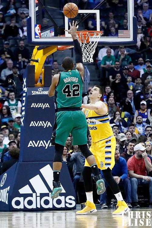 10 March 2017: Boston Celtics center Al Horford (42) takes a jump shot over Denver Nuggets forward Nikola Jokic (15) during the Denver Nuggets 119-99 victory over the Boston Celtics, at the Pepsi Center, Denver, Colorado, USA.