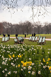 © Licensed to London News Pictures. 25/03/2015. Green Park, London, UK. Deckchairs are out for the public in the spring sunshine in Green Park, one of London's iconic parks. Photo credit : Stephen Chung/LNP
