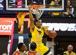 Feb 24, 2018; Morgantown, WV, USA; West Virginia Mountaineers forward Sagaba Konate (50) dunks the ball during the first half against the Iowa State Cyclones at WVU Coliseum. Mandatory Credit: Ben Queen-USA TODAY Sports