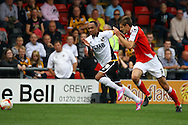 Port Vale&rsquo;s Byron Moore and Crewe Alexandre&rsquo;s Jon Guthrie chase the ball. Skybet football league one match, Crewe Alexandra v Port Vale at the Alexandra Stadium in Crewe on Saturday 13th Sept 2014.<br /> pic by Chris Stading, Andrew Orchard sports photography.