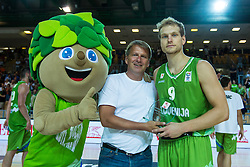 Jaka Blazic receiving trophy for best player during friendly basketball match between National teams of Slovenia and Ukraineat day 1 of Adecco Cup 2015, on August 21 in Koper, Slovenia. Photo by Grega Valancic / Sportida