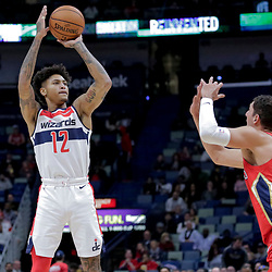 Nov 28, 2018; New Orleans, LA, USA; Washington Wizards forward Kelly Oubre Jr. (12) shoots over New Orleans Pelicans forward Nikola Mirotic (3) during the first quarter at the Smoothie King Center. Mandatory Credit: Derick E. Hingle-USA TODAY Sports