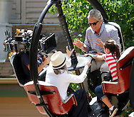"Michael Douglas, right, and Diane Keaton ride with a camera operator during filming of the movie ""And So It Goes"" on Monday at Lake Compounce in Bristol. (Photo by Kevin Bartram)"