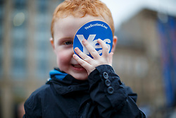 © Licensed to London News Pictures. 16/09/2014. Glasgow, UK. A child attending to a mass meeting by Yes voters and campaigners at George's Square in Glasgow city centre on the evening of Tuesday, 16 September, two days ahead of the Scottish independence referendum. Photo credit : Tolga Akmen/LNP