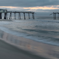 Sunrise surf fishing, old fishing pier, Cape Hatteras National Seashore, NC