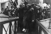 Harold Bride, surviving wireless operator of the TITANIC, with feet bandaged, being carried up ramp of ship]. Date Created/Published: c1912 May 27. Medium: 1 photographic print.