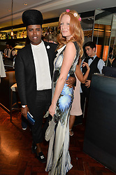 PRINCE CASSIUS and OLIVIA INGE at a dinner to celebrate 20 years of Maria Grachvogel's fashion label held at Salmontini, 1 Pont Street, London on 22nd October 2014.