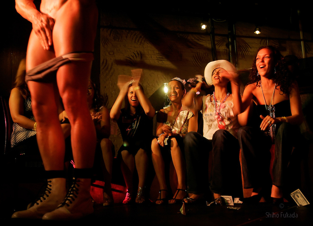 Male strippers perform in New York, Saturday, May 13, 2006.