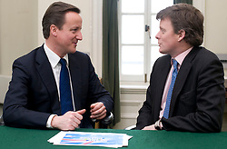 Leader of the Conservative Party David Cameron with Richard Benyon, Member of Parliament for Newbury. in his office in Norman Shaw South, January 18, 2010. Photo By Andrew Parsons / i-Images.