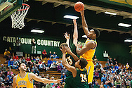 Vermont's Darren Payen (12) leaps to take a shot during the men's basketball game between the Lyndon State Hornets and the Vermont Catamounts at Patrick Gym on Saturday afternoon November 19, 2016 in Burlington (BRIAN JENKINS/for the FREE PRESS)