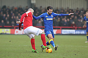 Charlton Athletic striker Tony Watt (7) battles for possesion with AFC Wimbledon defender George Francomb (7) during the EFL Sky Bet League 1 match between AFC Wimbledon and Charlton Athletic at the Cherry Red Records Stadium, Kingston, England on 11 February 2017. Photo by Matthew Redman.