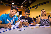 "18 AUGUST 2012 - PHOENIX, AZ:  Young people who hope to win ""deferred action"" status go over paperwork at a deferred action workshop in Phoenix. More than 1000 people attended a series of 90 minute workshops in Phoenix Saturday on the ""deferred action"" announced by President Obama in June. Under the plan, young people brought to the US without papers, would under certain circumstances, not be subject to deportation. The plan mirrors some aspects the DREAM Act (acronym for Development, Relief, and Education for Alien Minors), that immigration advocates have sought for years. The workshops were sponsored by No DREAM Deferred Coalition. PHOTO BY JACK KURTZ"