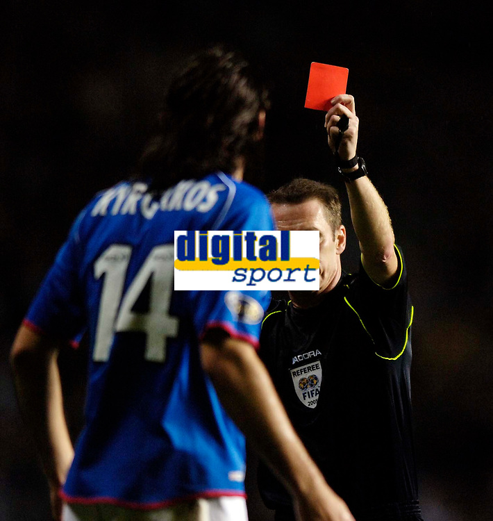 Photo: Jed Wee.<br /> Celtic v Glasgow Rangers. Scottish CIS Insurance Cup. <br /> 09/11/2005.<br /> <br /> Referee Kenny Clark (R) shows Rangers' Sotirios Kyrgiakos the red card following a second yellow card.