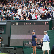 LONDON, ENGLAND - JULY 15:  Garbine Muguruza of Spain falls to her knees as the video replay confirms her victory in the Ladies Singles final as coach Conchita Martinez and family members celebrate in the family box during the Ladies Singles final against Venus Williams of The United States in the Wimbledon Lawn Tennis Championships at the All England Lawn Tennis and Croquet Club at Wimbledon on July 15, 2017 in London, England. (Photo by Tim Clayton/Corbis via Getty Images)
