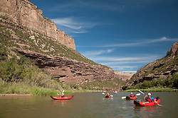 North America, United States, Colorado, Dinosaur National Monument, Green River, children in kayaks.  MR