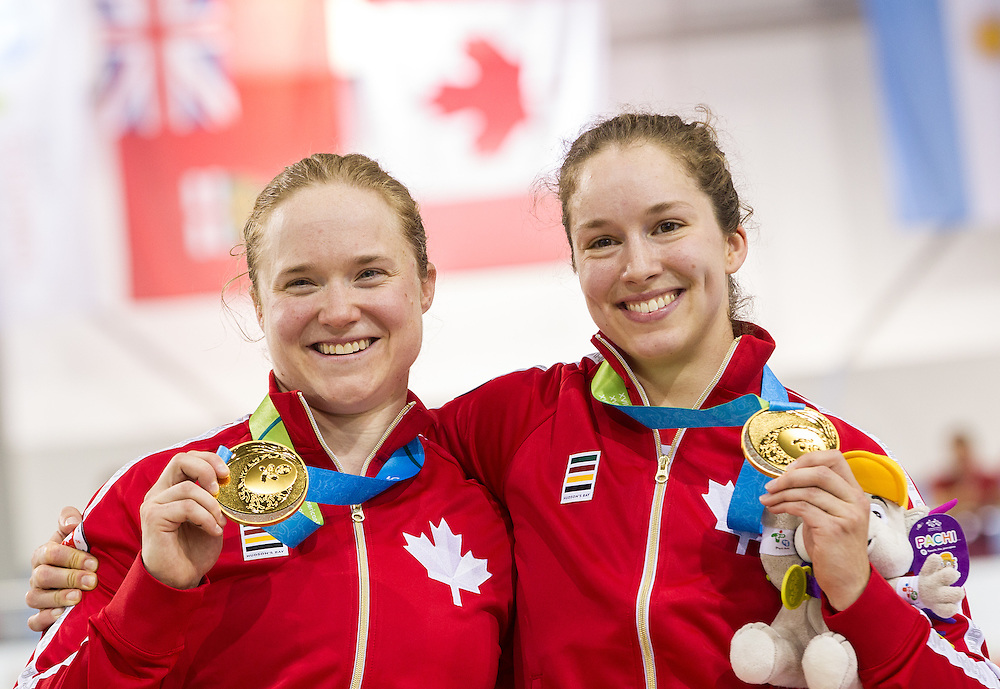 The Canadian team of Kate O'Brien (L) and Monique Sullivan pose with their gold medals in the women's team sprint final at the 2015 Pan American Games in Toronto, Canada, July 16,  2015.  AFP PHOTO/GEOFF ROBINS