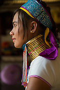 Young Padaung woman wearing brass neck rings, Inle Lake, Burma