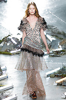 Hollie-May Saker (Trump) walks the runway wearing Rodarte Fall 2015 during Mercedes-Benz Fashion Week in New York on February 17, 2015