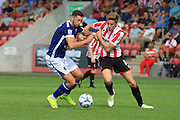 Andy Howarth and Asa Hall during the Vanarama National League match between Cheltenham Town and Barrow at Whaddon Road, Cheltenham, England on 22 August 2015. Photo by Antony Thompson.