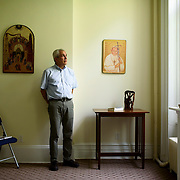 June 1, 2016 - New York, NY : The Missionary Sisters of the Immaculate Heart of Mary (I.C.M.)  are selling their 25-bedroom, two-story, combined two-townhome property located at 236 East 15th Street. Here, Michael Guglielmo, a member of the Community of Sant'Egidio which used to occupy two floors of one of the adjoined townhomes, poses for a portrait in what was the Sant'Egidio prayer chapel on the building's second floor. CREDIT: Karsten Moran for The New York Times