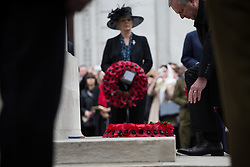 The Anzac Day tradition -WW1 memorial. New Zealand High Commissioner to the UK Sir Alexander Lockwood Smith, right, and Australian High Commissioner to the UK Mike Rann lay wreaths during a service of remembrance at the Cenotaph on Whitehall, London, United Kingdom. Friday, 25th April 2014. Picture by Daniel Leal-Olivas / i-Images