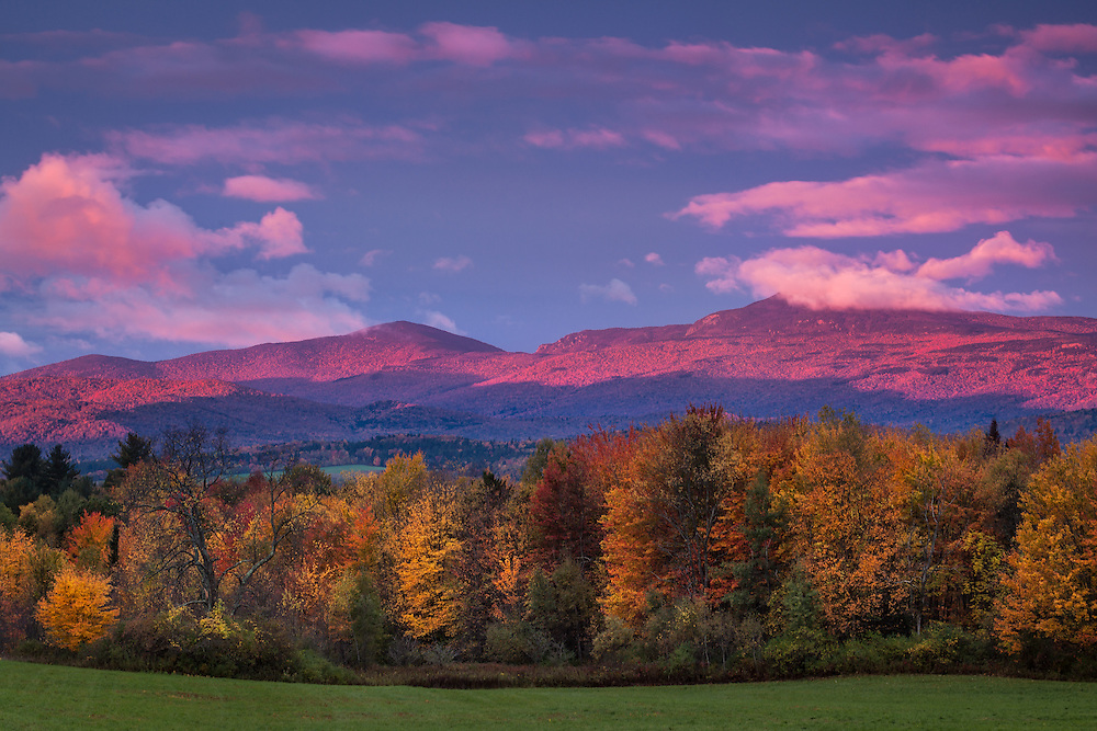 Camel's Hump turns purple against a stormy sky at sunrise, Waterbury Ctr, Vermont