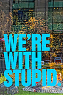"""""""We're with Stupid"""" big blue letters written on store window of Diesel Flagship store on 5th Avenue, 685 Fifth Avenue, Manhattan, NYC, 10022, on Febraury 28, 2010"""