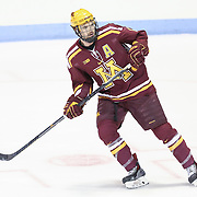 Seth Ambroz #17 of the Minnesota Gophers is seen on the ice prior to the game against the Northeastern Huskies at Matthews Arena on November 29, 2014 in Boston, Massachusetts. (Photo by Elan Kawesch)