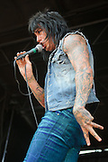 Falling in Reverse performing at Warped Tour at the Verizon Wireless Amphitheater in St. Louis on July 5, 2012.