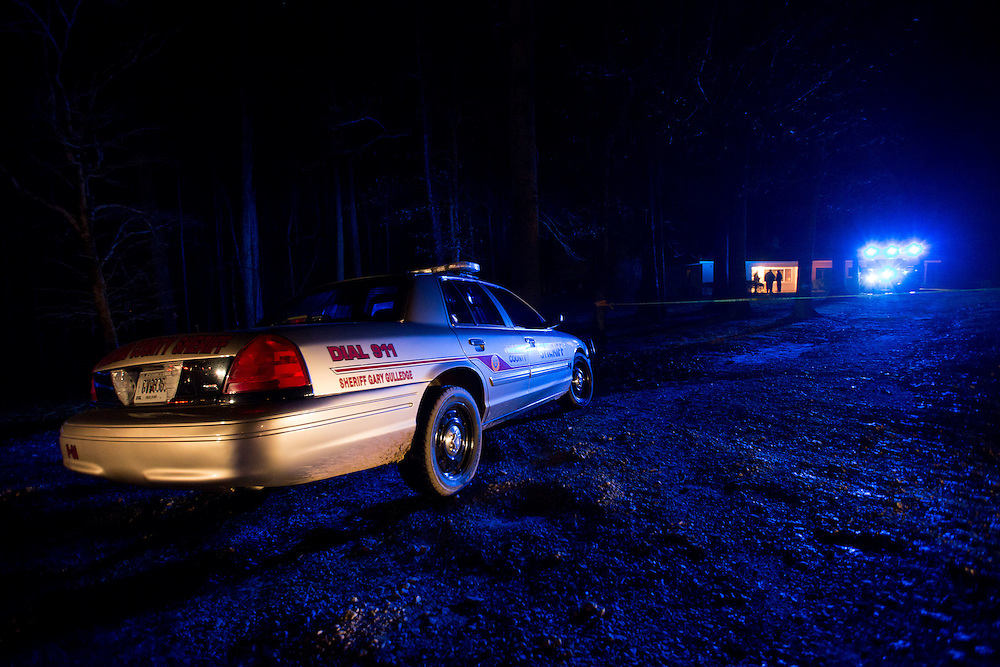 View of on house on Ridge Road in unincorporated Paulding County, Ga., where a triple murder/suicide took place on Jan. 6, 2015. A Paulding County Sheriff's Office Corporal was among those killed. (AP Photo/Kevin Liles)
