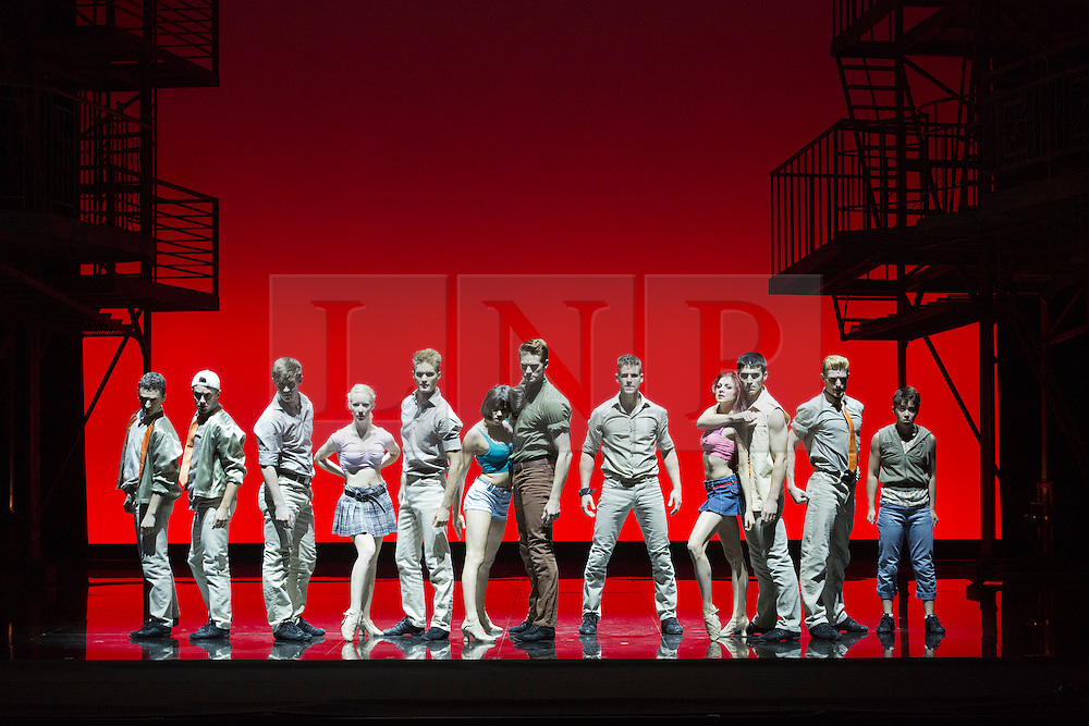 """© Licensed to London News Pictures. 07/08/2013. London, England. Pictured: Jet Girls and Jet Men dancing. The musical """"West Side Story"""" returns to Sadler's Wells Theatre from 7 August to 22 September 2013 before embarking on a nationwide tour. Book by Arthur Laurents, music by Leonard Bernstein and lyrics by Stephen Sondheim. The entire original production directed and choreographed by Jerome Robbins. With Elena Sancho Pereg as Maria and Liam Tobin as Tony. Photo credit: Bettina Strenske/LNP"""