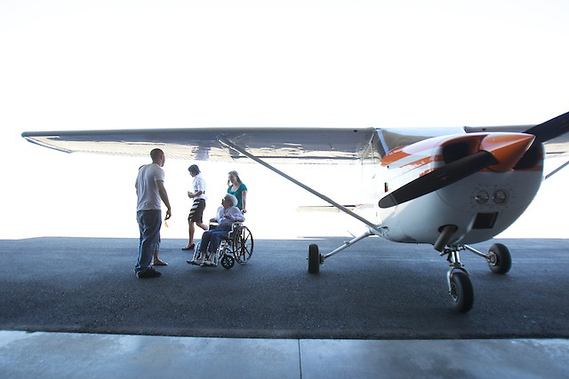 Janet Smith takes a plane ride with her grandchildren after the event was coordinated by Hospice of North Idaho on Monday, August 1, 2011 at the Coeur d'Alene Airport.
