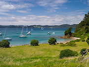 Eastward view from Motuarohia Island across the Bay of Islands. Sailboats moored.