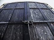 Looming locked wooden door