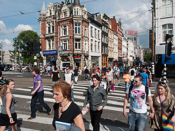 Busy pedestrian crossing in central Amsterdam The Netherlands