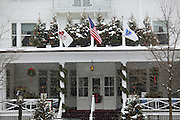 Snow falling on The Red Lion Inn of Stockbridge, Massachusetts decorated for the holidays.