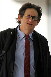 © Licensed to London News Pictures. 06/10/2011, London, UK. Editor of Guardian newspaper Alan Rusbridger arrives at the Queen Elizabeth II centre in London for the Leveson Inquiry seminars, Thursday, Oct. 6, 2011. The seminars explore the competitive pressures on the press and the rights and responsibilities of the press. The Leveson Inquiry to take place later in the year and will look into the culture, practices and ethics of the press after recent revelations of journalists hacking into phones. Photo credit : Sang Tan/LNP