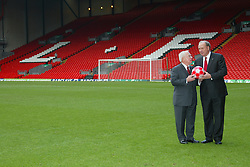 Liverpool, England - Tuesday, February 6th, 2007: American tycoons George Gillett (L) and Tom Hicks (R) on the pitch at Anfield after announcing their take-over of Liverpool Football Club in a deal worth around £470 million. Texan billionaire Hicks, who owns the Dallas Stars ice hockey team and the Texas Rangers baseball team, has teamed up with Montreal Canadiens owner Gillett to put together a joint £450m package to buy out shareholders, service the club's existing debt and provide funding for the planned new stadium in Stanley Park. (Pic by Dave Kendall/Propaganda)