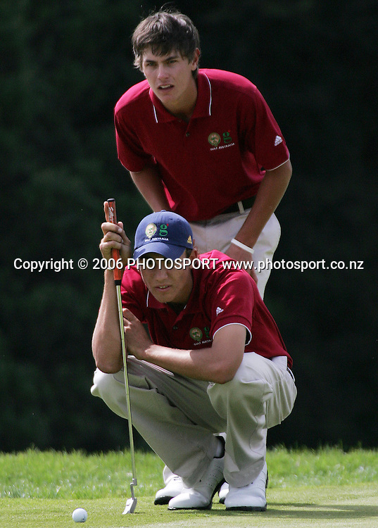 Australia's Matt Jager (kneeling) and Jason Scrivener read a putt during the Clare Higson Trophy foursomes match between New Zealand's Samuel Shin and Danny Lee and Australia's Matt Jager and Jason Scrivener at Hamilton Golf Club in Hamilton, New Zealand on Wednesday 27 September, 2006. Scrivener and Jager won the match 2 and 1. Photo: Tim Hales/PHOTOSPORT